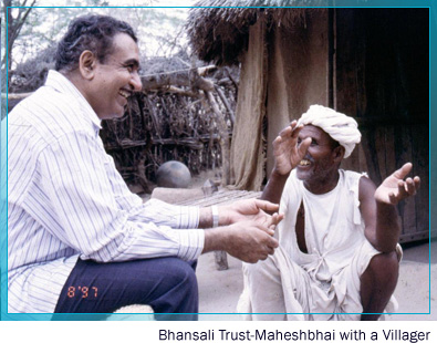 Bhansali trust - Maheshbhai with a villager
